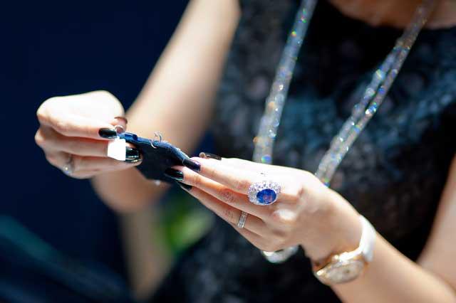 Lady studying jewellery
